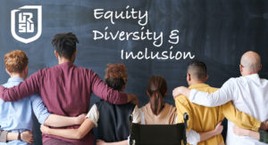 """A group of people facing a blackboard with their backs to the viewer. They are side-by-side with their arms on each others' shoulders or hips. On the blackboard in chalk are the words """"Equity, Diversity & Inclusion"""""""